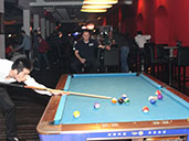 Patrons playing pool at Club Viva in Futian.