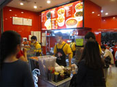 Workers taking orders at The Happy Fish Ball
