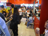 Customers eating at The Happy Fish Ball