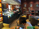 Customers relaxing at Bear's Coffee in Futian near Che Gong Miao.