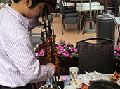 Waiter serving chicken from a skewer at Amazon BBQ Bar.